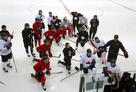 Members of the Canadian women's ice hockey team attend a practice session ahead of the 2014 Sochi Winter Olympics February 7, 2014. REUTERS/