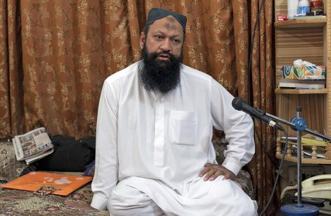 Leader of the Lashkar-e-Jhangvi (LeJ) Malik Ishaq speaks during an interview with Reuters at his home in Rahim Yar Khan in southern Punjab p
