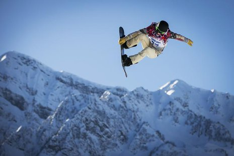 U.S. snowboarder Shaun White goes off a jump during snowboard slopestyle training at the 2014 Sochi Winter Olympics in Rosa Khutor February