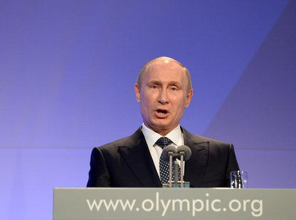 Russian President Vladimir Putin delivers his speech at the International Olympic Committee (IOC) Gala Dinner at the 2014 Sochi Winter Olymp