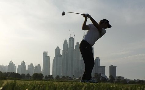Edoardo Molinari from Italy takes his tee shot on the 8th hole during the first round of the 2014 Omega Dubai Desert Classic in Dubai Januar
