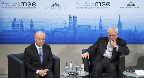International Atomic Energy Agency (IAEA) Director General Yukiya Amano (L) and Iran's Foreign Minister Mohammad Javad Zarif attend the annu