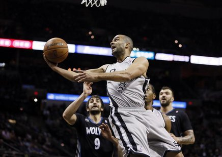 Jan 12, 2014; San Antonio, TX, USA; San Antonio Spurs guard Tony Parker (9) drives to the basket past Minnesota Timberwolves guard Ricky Rub