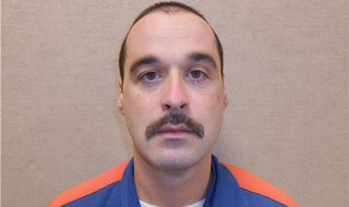Michael David Elliot, 40, shown in this Michigan Department of Corrections photo, escaped from Ionia Correctional Facility in Ionia, Michiga