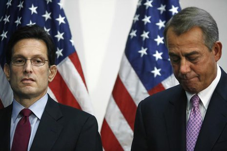 U.S. House Majority Leader Eric Cantor (R-VA) (L) stands with House Speaker John Boehner (R-OH) at a news conference after a House Republica