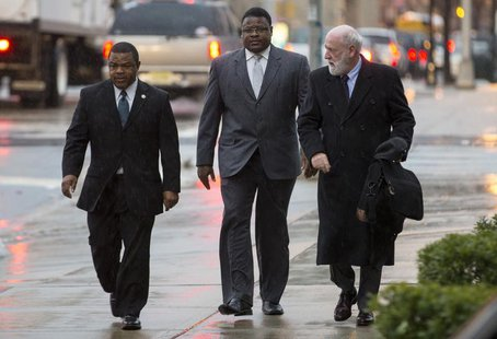 Trenton New Jersey Mayor Tony Mack (L) and his brother Ralphiel Mack (center) arrive at United States Court in Trenton, New Jersey, January