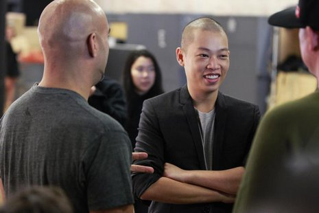 Designer Jason Wu laughs backstage while preparing to present his Spring/Summer 2014 collection during New York Fashion Week September 6, 20