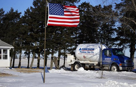 Arenson Oil and Propane delivery driver Don Bedford pulls the hose to fill up empty propane tanks in Sandwich, Illinois January 29, 2014. RE