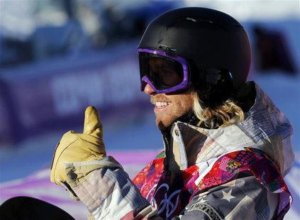 Sage Kotsenburg of the U.S. gestures after arriving on the finish line during the men's snowboard slopestyle semi-final competition at the 2