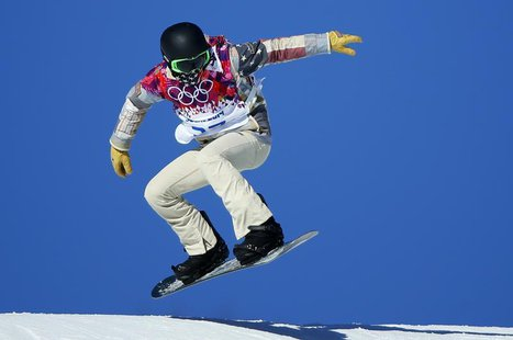 U.S. snowboarder Shaun White speeds down the hill during snowboard slopestyle training at the 2014 Sochi Winter Olympics in Rosa Khutor, Feb