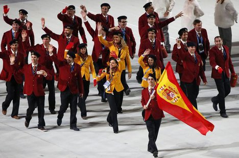 Spain's flag-bearer Javier Fernandez leads his country's contingent during the opening ceremony of the 2014 Sochi Winter Olympics, February
