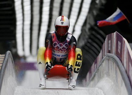 Germany's Felix Loch speeds down the track during the men's singles luge competition at the 2014 Sochi Winter Olympics, at the Sanki Sliding