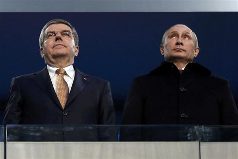 International Olympic Committee (IOC) President Thomas Bach of Germany and Russian President Vladimir Putin (R) stand together during the op