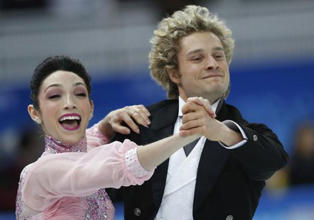 Meryl Davis (L) and Charlie White of the U.S. compete during the figure skating team ice dance short dance at the Sochi 2014 Winter Olympics