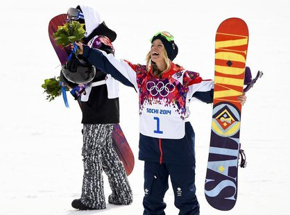 Third placed Britain's Jenny Jones gestures during flower ceremony after competing in the women's snowboard slopestyle finals event at the 2