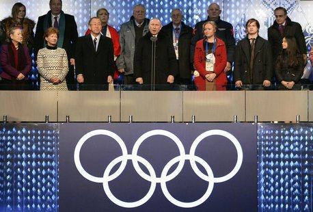 Russian President Vladimir Putin (C) declares the Olympic Games open during the opening ceremony of the 2014 Sochi Winter Olympics at the Fi