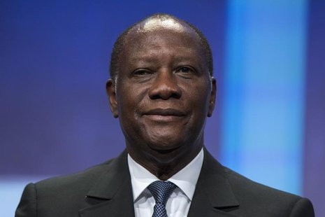 President of Ivory Coast Alassane Ouattara sits on stage in support of a commitment to stop poaching of African elephants announced at the C