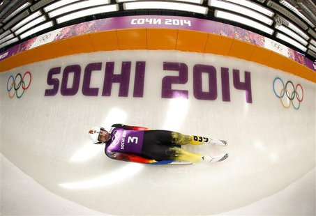 Germany's Andi Langenhan speeds down the track during a men luge training at the Sanki sliding center in Rosa Khutor, a venue for the 2014 S