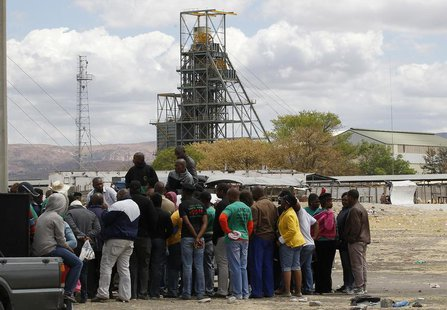 Miners gather near the Anglo American Platinum's Thembelani mine near the mining town of Rustenburg, northwest of Johannesburg September 30,