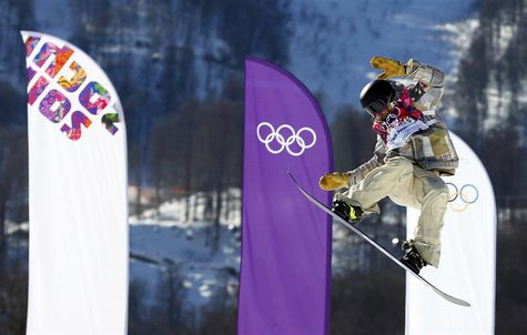 Sage Kotsenburg of the U.S. performs a jump during the men's snowboard slopestyle final at the 2014 Sochi Olympic Games in Rosa Khutor Febru