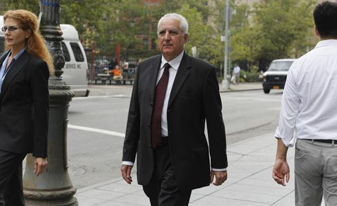 Former Bernard L. Madoff Investment Securities LLC. operations officer Daniel Bonventre (C) departs Manhattan Federal Court in New York, Aug