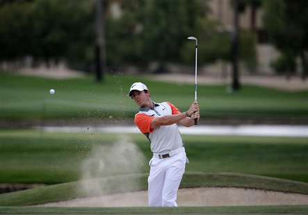 Rory McIlroy of Northern Ireland hits the ball out of the bunker on the 13th hole during the final round of the 2014 Omega Dubai Desert Clas