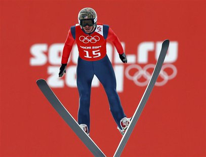 Todd Lodwick from the U.S. soars through the air during the training of the normal hill ski jumping portion of the Nordic Combined individua