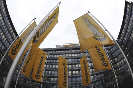 Flags of Germany's Continental AG hang in the rain during a board meeting of Continental in Frankfurt, in this March 6, 2009 file photo. REU
