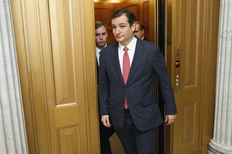 U.S. Senator Ted Cruz (R-TX) walks to the Senate floor for a vote on a $1.1 trillion U.S. spending bill at the U.S. Capitol in Washington, J