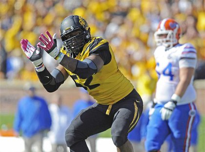 Missouri Tigers defensive lineman Michael Sam (52) celebrates after sacking Florida Gators quarterback Tyler Murphy (not pictured) during th