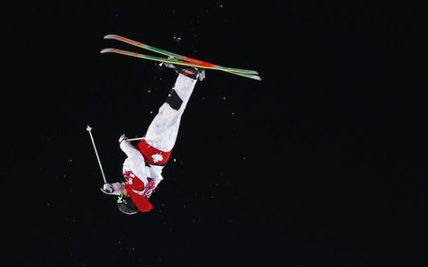 Canada's Alex Bilodeau performs a jump during the men's freestyle skiing moguls finals at the 2014 Sochi Winter Olympic Games in Rosa Khutor