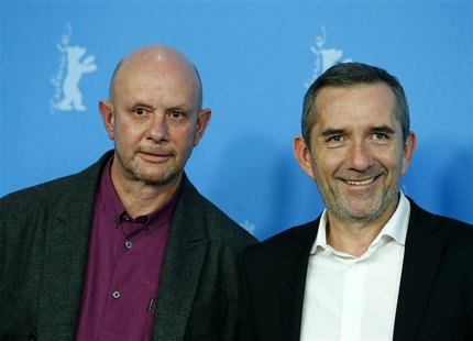 "Director Pascal Chaumeil (R) and writer Nick Hornby pose during a photocall to promote the movie ""A Long Way Down"" at the 64th Berlinale Int"