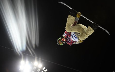 Shaun White of the U.S. performs a jump during a training session for the snowboard men's halfpipe competition at the 2014 Sochi Winter Olym