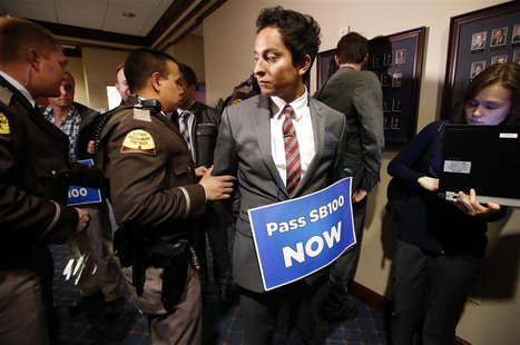 LGBT rights activist are detained by members of the Utah Highway Patrol after blocking a Senate committee hearing room at the Utah State Cap
