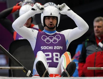 India's Shiva Keshavan prepares for the start during the men's luge training at the Sanki sliding center in Rosa Khutor, a venue for the Soc