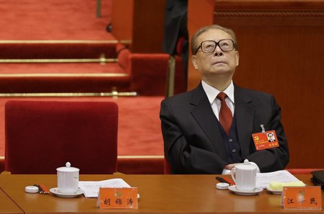 China's former President Jiang Zemin looks up while President Hu Jintao gives his speech during the opening ceremony of 18th National Congre