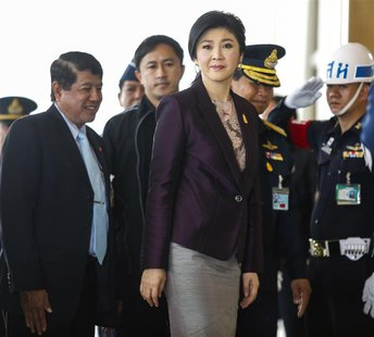 Thailand Prime Minister Yingluck Shinawatra (C) arrives at the Royal Thai Air Force headquarters before a cabinet meeting in Bangkok Februar