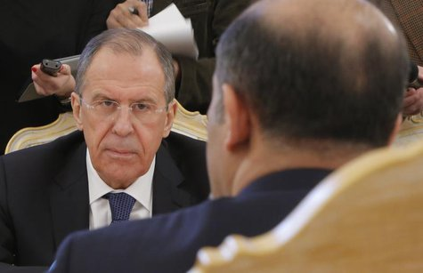 Russia's Foreign Minister Sergei Lavrov listens during a meeting with Syrian opposition leader Ahmad Jarba in Moscow February 4, 2014. REUTE