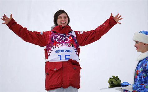 Canada's third-placed Kim Lamarre celebrates on podium during a flower ceremony after the women's freestyle skiing slopestyle finals at the