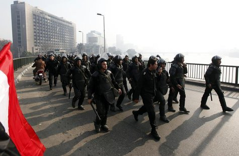 Riot police are seen on October bridge during clashes with anti-government protesters and members of the Muslim Brotherhood, near Tahrir Squ