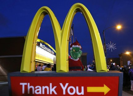 "A protestor dressed up as the fictional character the ""Grinch"" demonstrates outside a McDonald's restaurant in Chicago, Illinois, December 5"