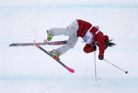 Canada's Yuki Tsubota crashes during the women's freestyle skiing slopestyle finals at the 2014 Sochi Winter Olympic Games in Rosa Khutor Fe