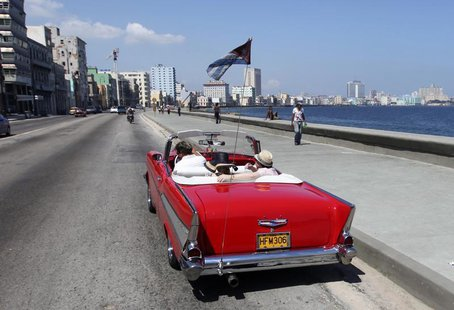 Tourists ride a U.S.-made 1957 Chevrolet Bel-Air convertible car on Havana's seafront boulevard 'El Malecon' May 21, 2013. REUTERS/Desmond B