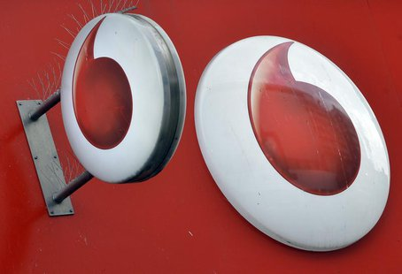 Vodafone branding is seen outside a retail store in London November 12, 2013. REUTERS/Toby Melville