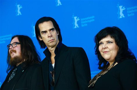"Directors Ian Forsyth (L) and Jane Pollard (R) pose with cast member Nick Cave during a photocall promoting the movie ""20,000 Days on Earth"""