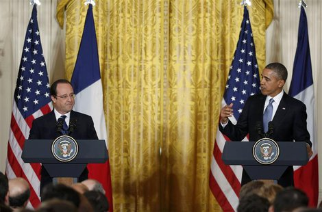U.S. President Barack Obama (R) and French President Francois Hollande address a joint news conference in the East Room of the White House i