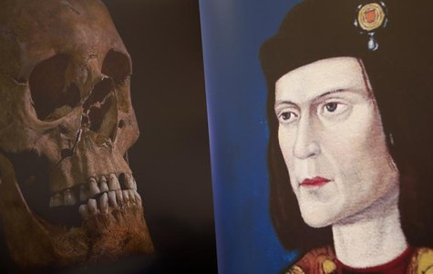 A television image of King Richard III's skull is seen next to a portrait of him during a news conference in Leicester, central England Febr