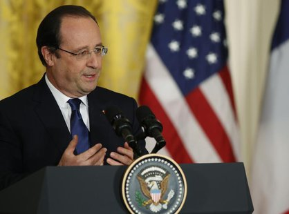 French President Francois Hollande addresses a joint news conference with U.S. President Barack Obama in the East Room of the White House in