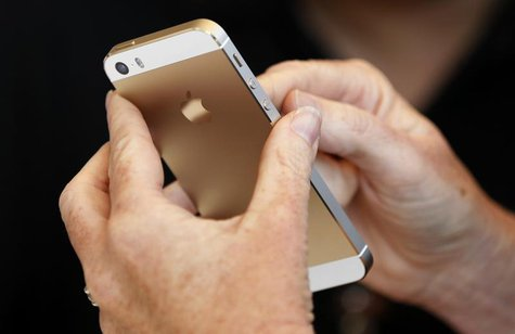 The gold colored version of the new iPhone 5S is seen after Apple Inc's media event in Cupertino, California September 10, 2013. REUTERS/Ste