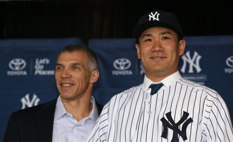Feb 11, 2014; Bronx, NY, USA; New York Yankees manager Joe Girardi introduces new right hand pitcher Masahiro Tanaka, during press conferenc